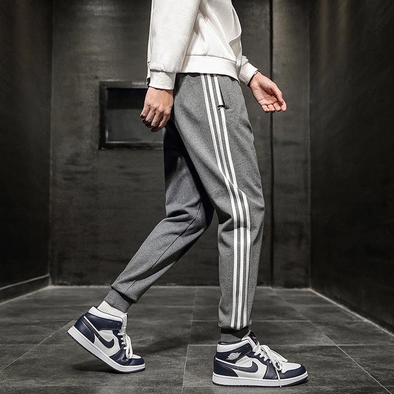 秋の2020新型男性用ビッグサイズの夜の光の束の足の9分のハーレムの若い男性用の運動のゆったりしたズボン