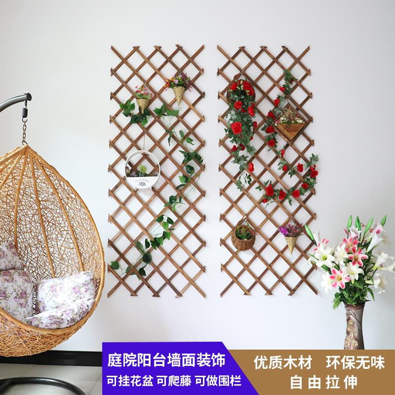 防腐木のベランダの植木鉢の棚は室内の壁面に飾ります。壁を掛けて、グリッドを掛けて、藤棚に登ります。
