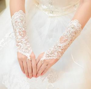 热卖的新娘婚纱长款手套绑带无指露指车骨花水钻手套新娘婚纱春夏