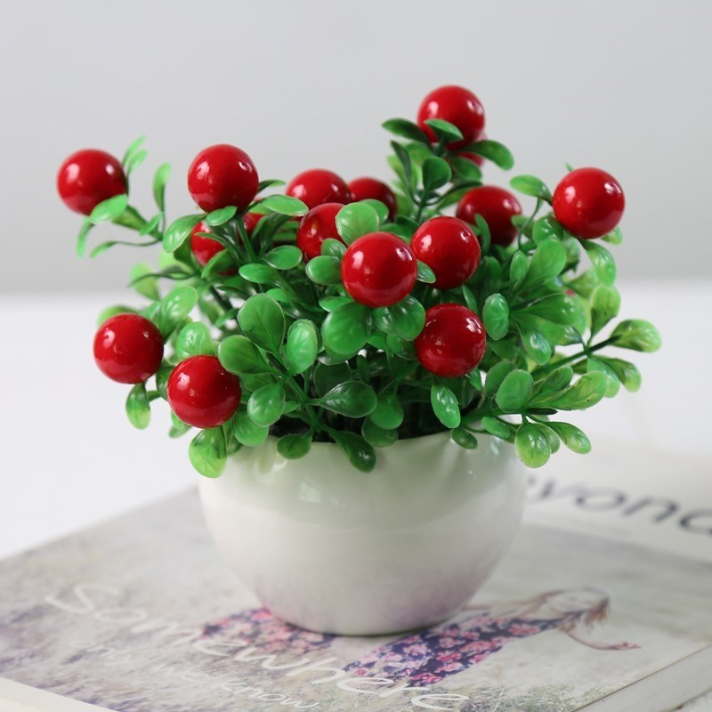 The house is decorated with dried flower bouquets, vases, living rooms, flowers and branches. The new years new years Day artificial large pot plants