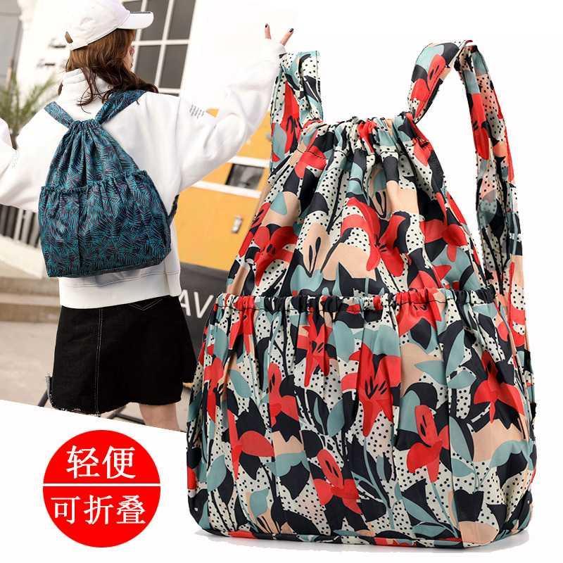 。牛津双肩包女士2020新款轻便折叠大容量抽绳束口袋印花旅行背包