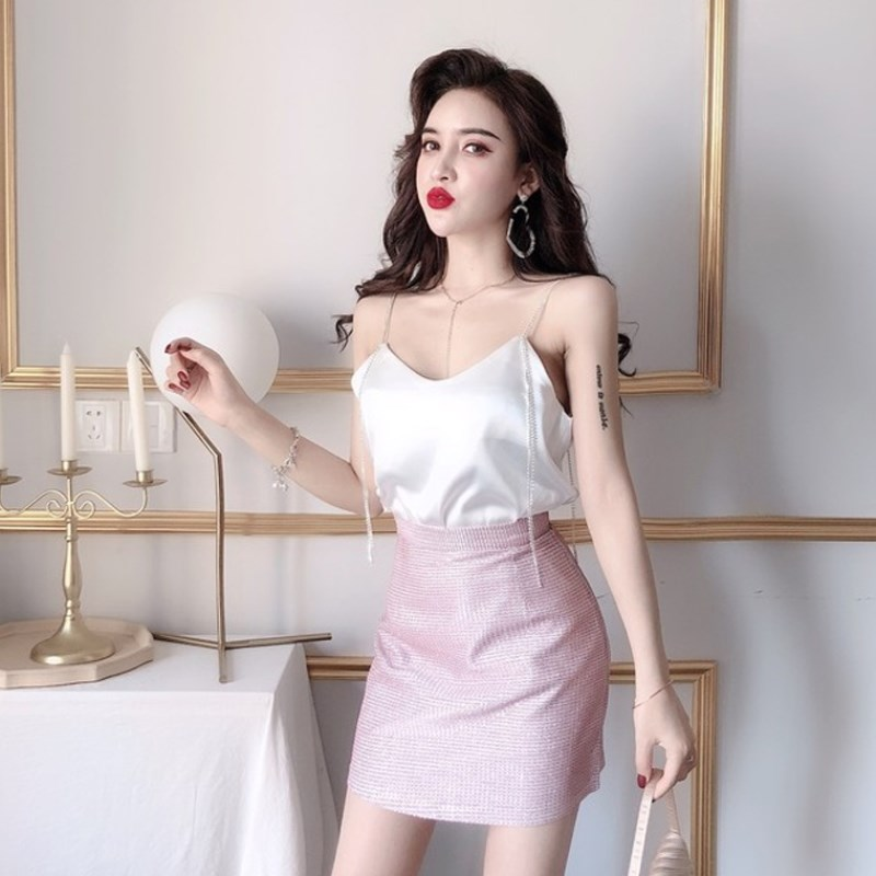 Net red suit fashionable two-piece set sexy low chest leaky back Sequin suspender Top + high waist bright silk hip skirt