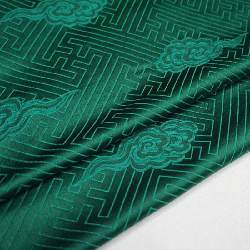 クラシックグリーンの中国風模様の祥雲織の錦の布/雲錦の絹の緞子の生地/時代の半メートル