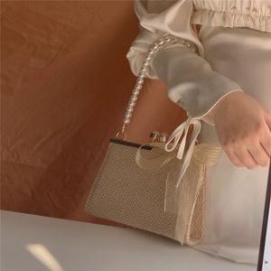 2021新款夏季仙女包纯色编织百搭包包草编单肩包蝴蝶结珍珠链条包