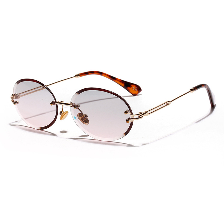 New oval Sunglasses European and American foreign trade frameless edge cutting fashion glasses popular personality Sunglasses men and women Retro