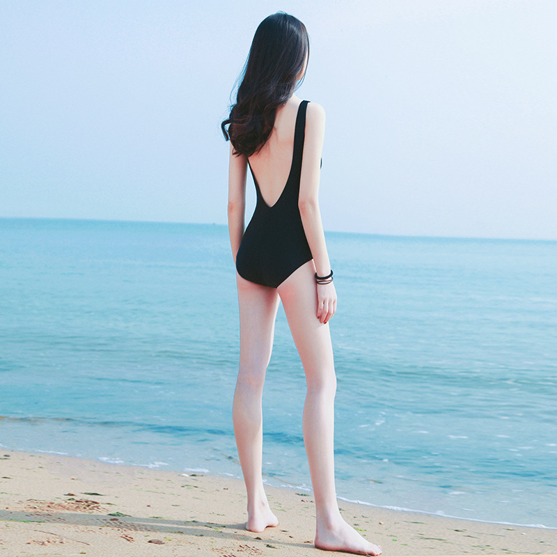 Korean holiday swimsuit girls one-piece net red sexy beautiful back show thin cover belly wind bareback black fairy Beach