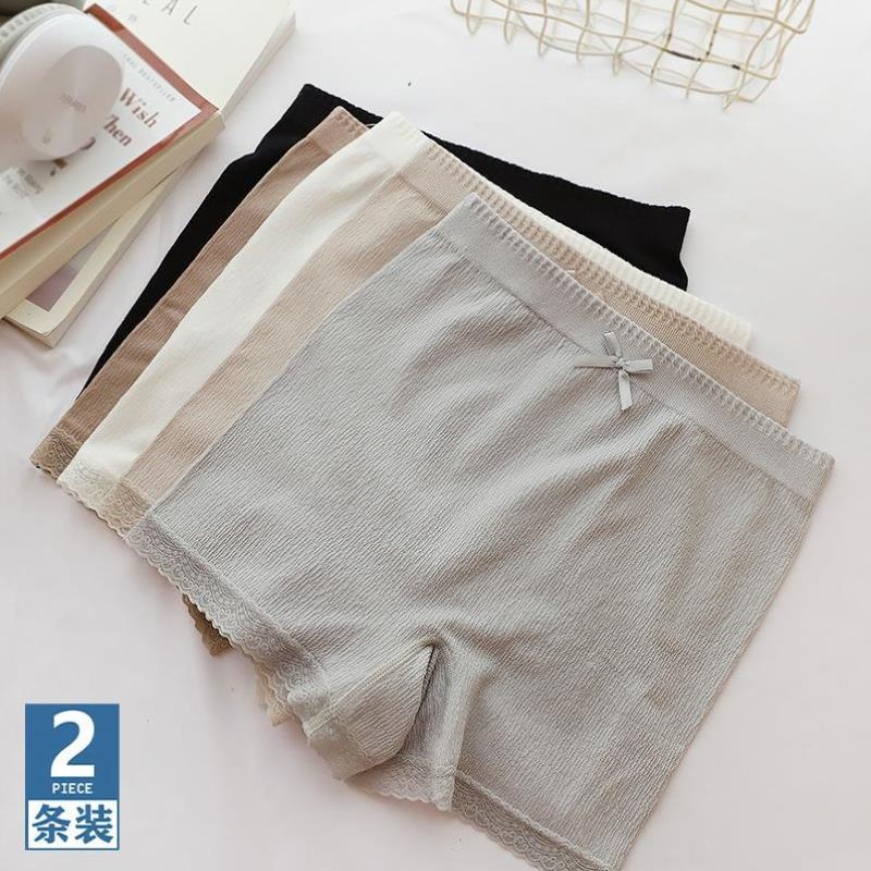 パンツの安全ズボンの脱光防止の二合の女性の高弾シームレスな大サイズの無傷の三分のズボンは巻かずに底の半ズボンを打ちます。