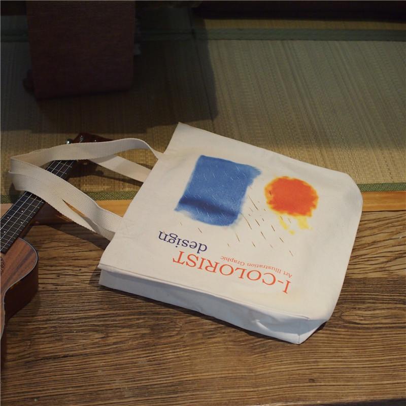 色彩工坊原创设计太阳雨女帆布包满33.00元可用1元优惠券