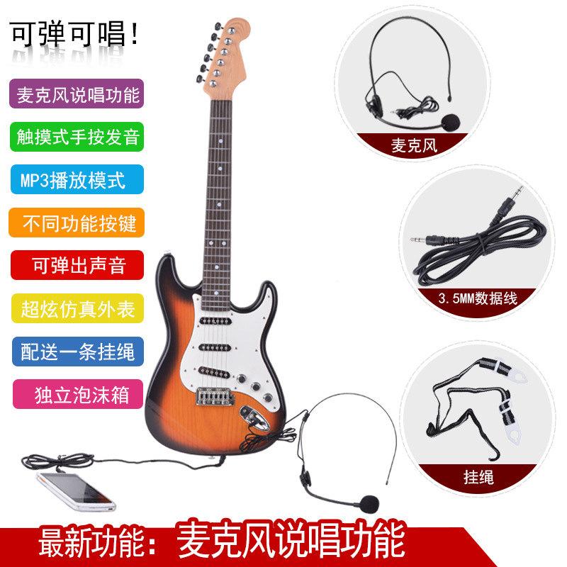 新型の男性の女の子の六弦の手はギターの子供を弾きます。