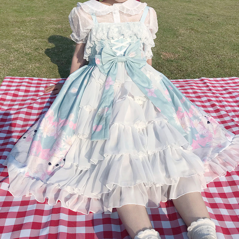 Lolita with short sleeve top and thin white base coat with Lolita skirt