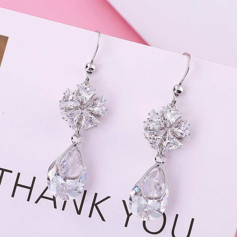 S925银花朵耳环女气质韩国简约长款耳钉水晶日韩时尚显脸瘦的耳坠