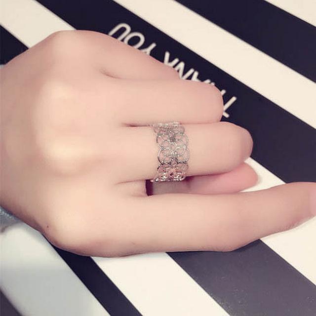 新款时尚韩版欧美流行风精致银色镂空花朵气质戒指女复古食指指环