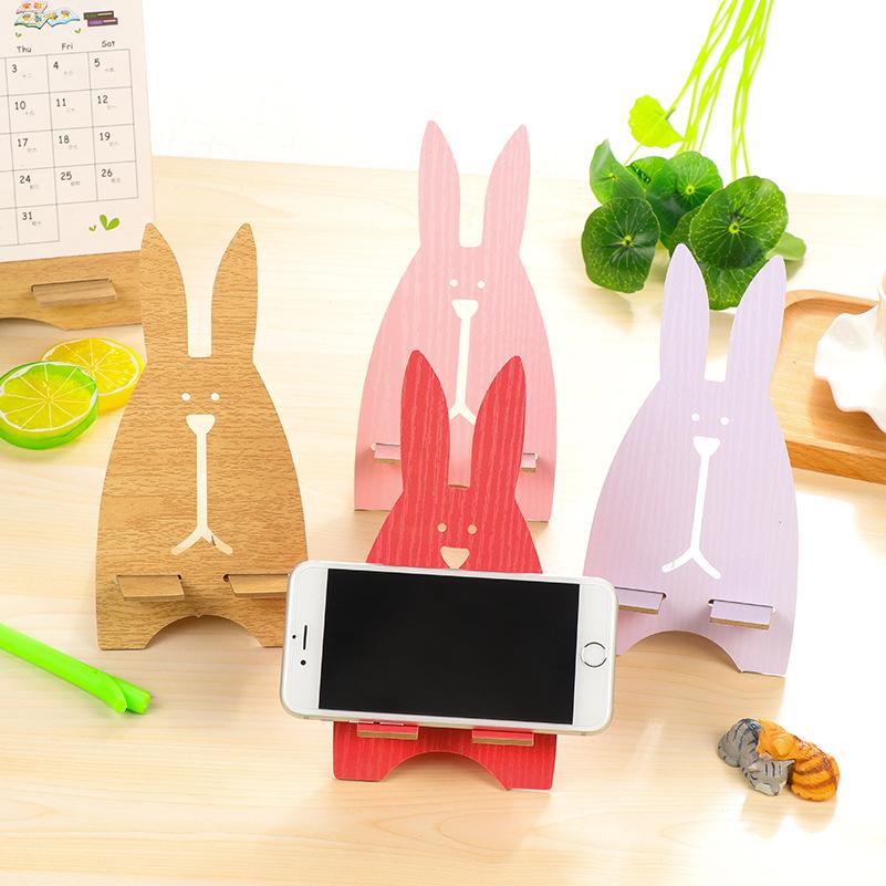 淘时光●韩国创意手机座可爱越狱兔手机支架 木质手机架 手机托架