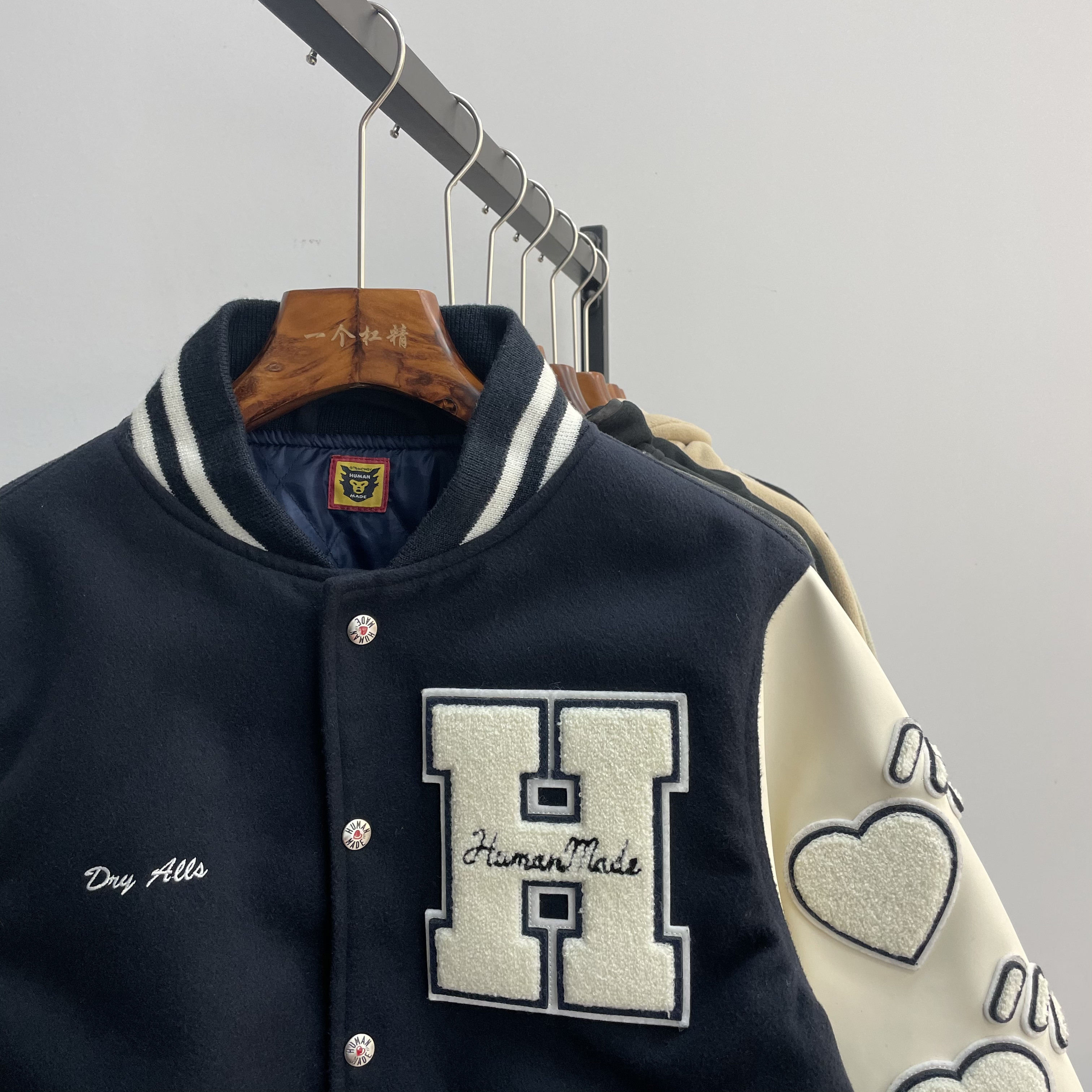 The correct version of Nigo Human Made autumn and winter new Mao Ni leather sleeve baseball jacket jacket men and women couples