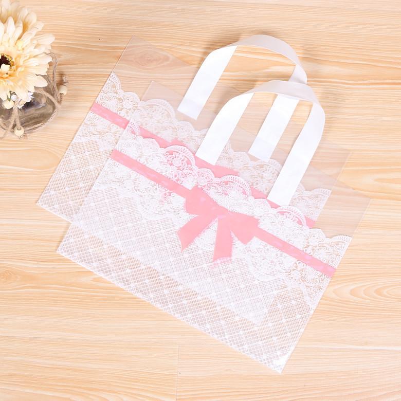 包邮加厚蝴蝶结女装童装店塑料手提袋胶袋礼品购物袋化妆品塑料袋