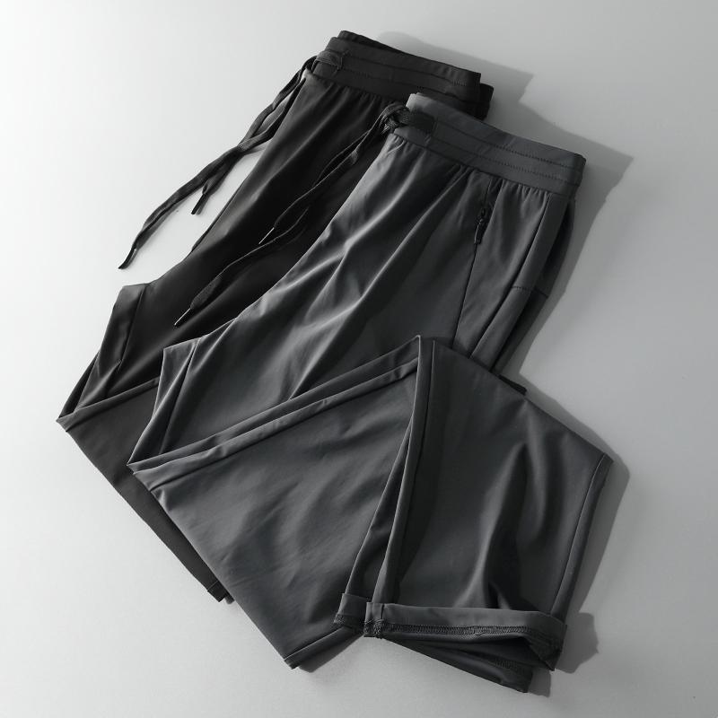 海e柜男装 锦纶冰丝面料20夏季黑色松紧腰户外休闲直筒弹力运动裤