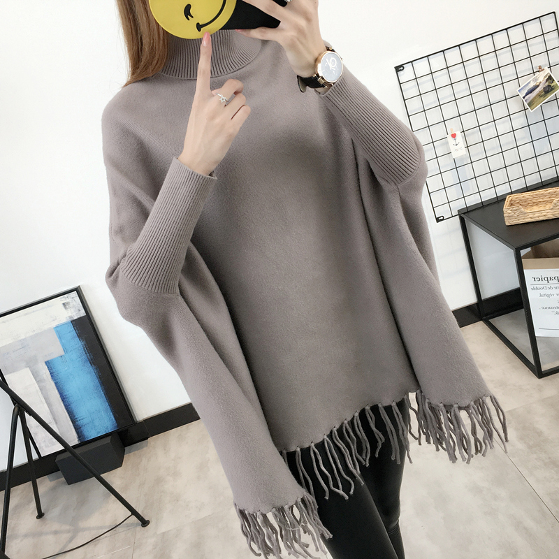 Autumn and winter womens Korean version medium length high neck sweater womens loose Cape high neck solid color fringe knitting coat