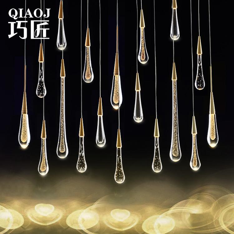 後近代的な水晶のガラスのつり下げのアイデアの水滴のレストランのカウンターのデザイナーの流星雨の多い頭の階段の間の長い明かり
