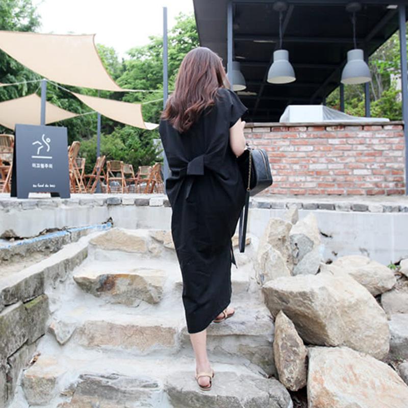 券后89.00元夏季女装新款韩版宽松大码后背拧折黑色连衣裙不规则开叉过膝长裙
