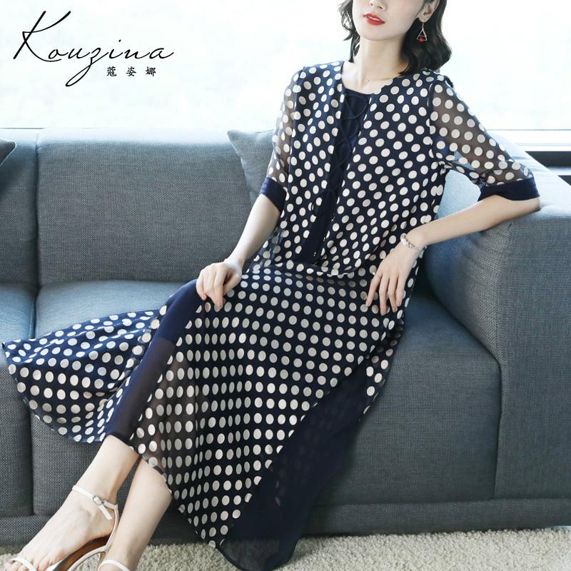 蔻姿娜女式天丝连衣裙2018夏装新款时尚气质黑白波点中长款裙子潮