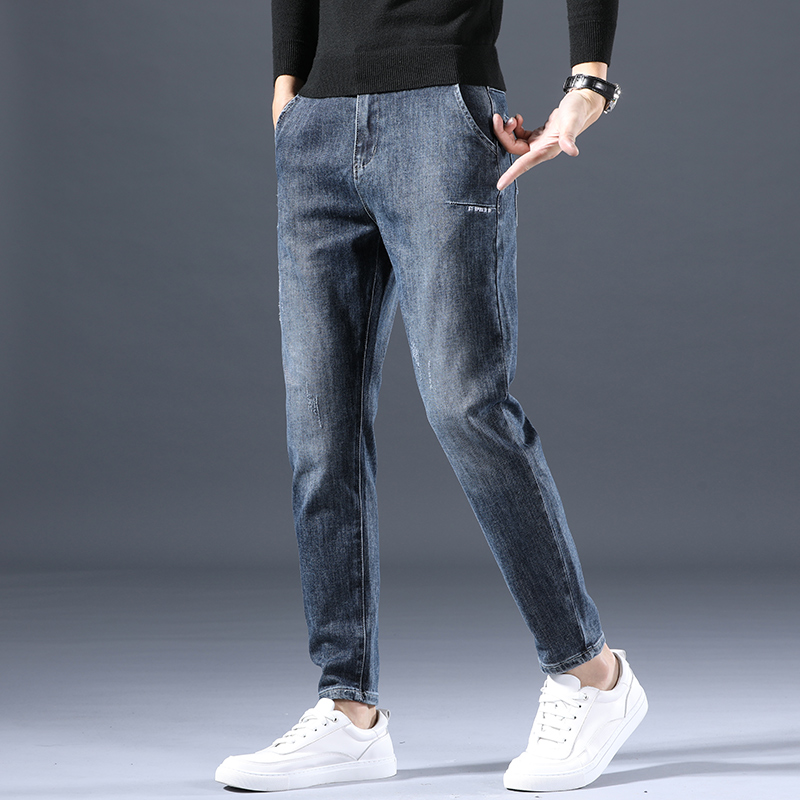 Hong Kong tidal card high-end jeans male 2021 new slim small foot casual long pants men's summer thin section
