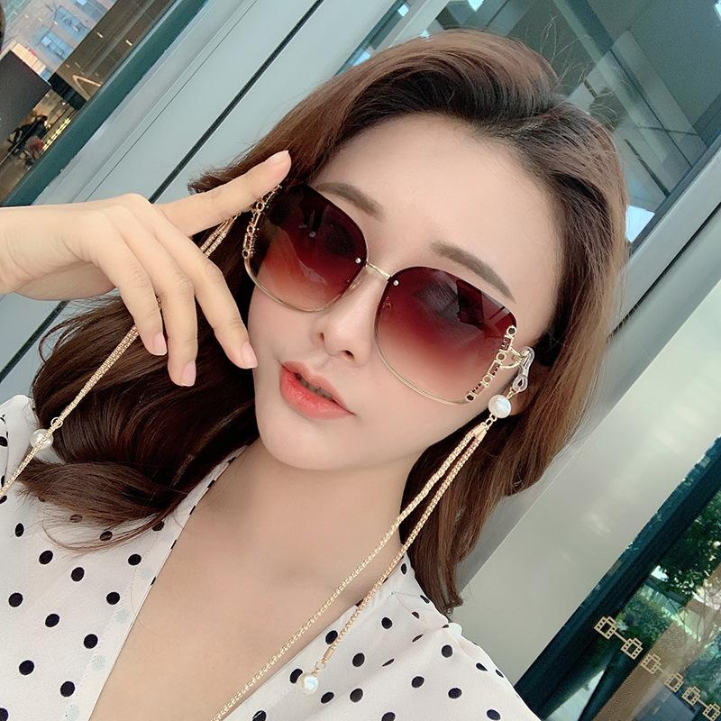 2021 new Korean red chain Sunglasses Womens fashion frameless personality pearl Lady Elegant Sunglasses Street Photo