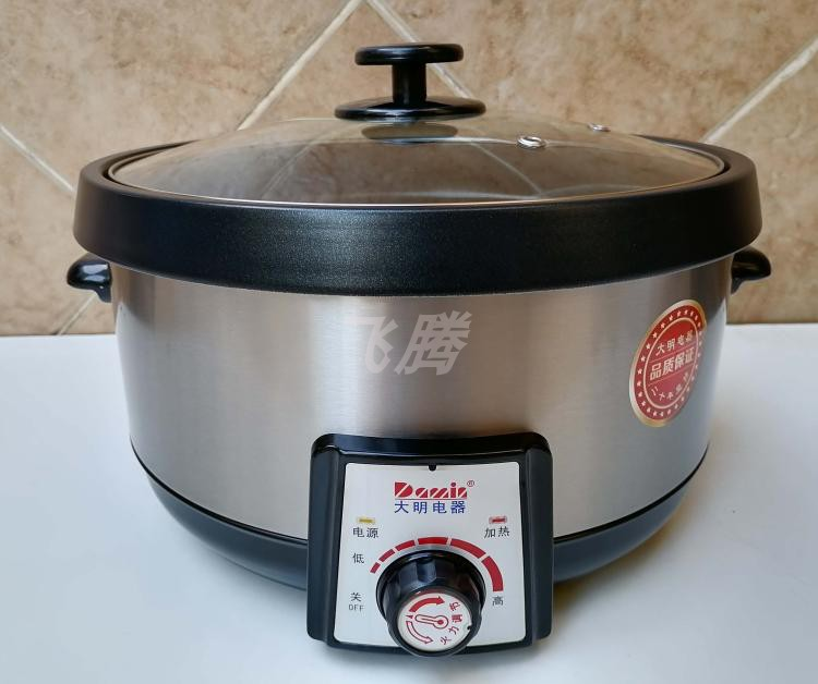 Daming Electric 6.3l electric hot pot 2000W / 8L split non stick inner liner with steam slice sauna pot for household and commercial use