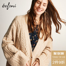 He Sui, the same Evelyn knitted cardigan woman, wears a loose medium-length sweater jacket over the new spring dress of 2019