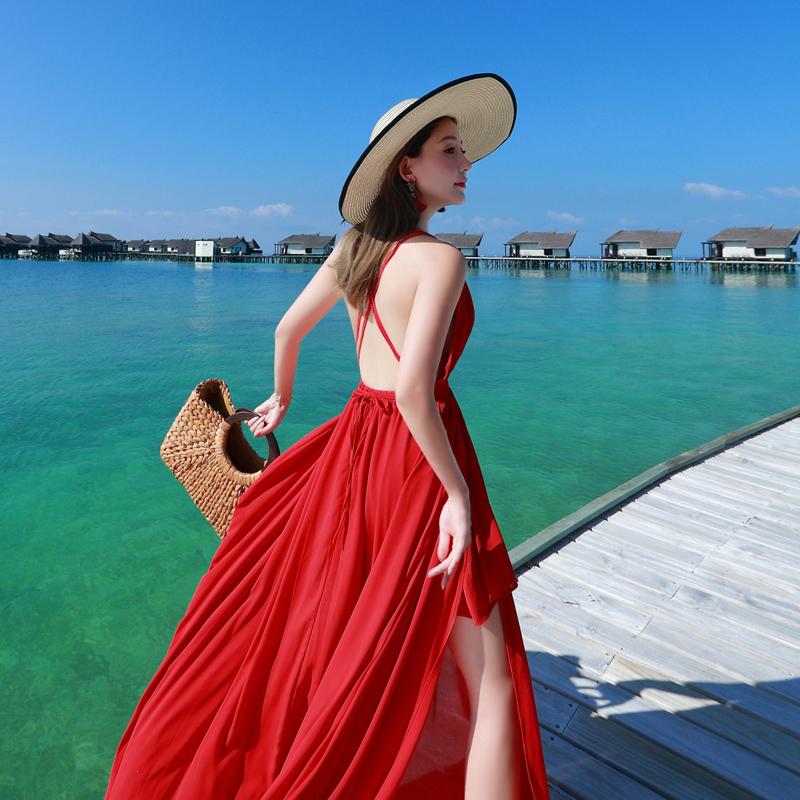 沙灘裙子仙女夏2019新款海邊度假性感露背泰國旅游吊帶連衣裙長裙
