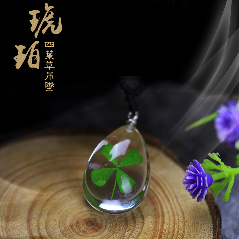 Bag mail special artificial amber sample Necklace four leaf grass pendant creative male and female student couple water drop jewelry