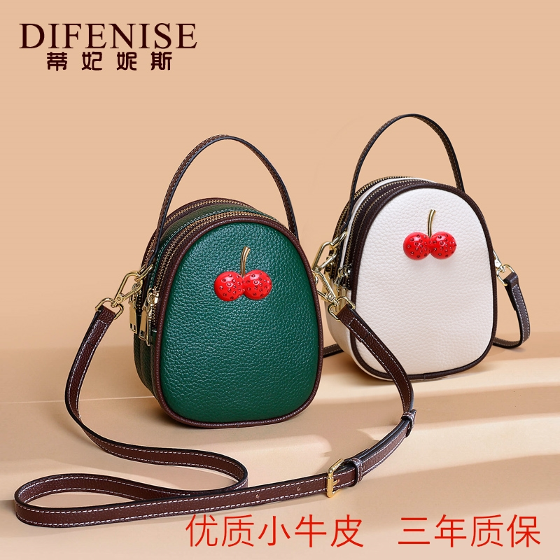 Leather Shoulder Bag Korean version net red popular multi-layer hand-held bag 20 fashion trend cherry cross small round bag for women