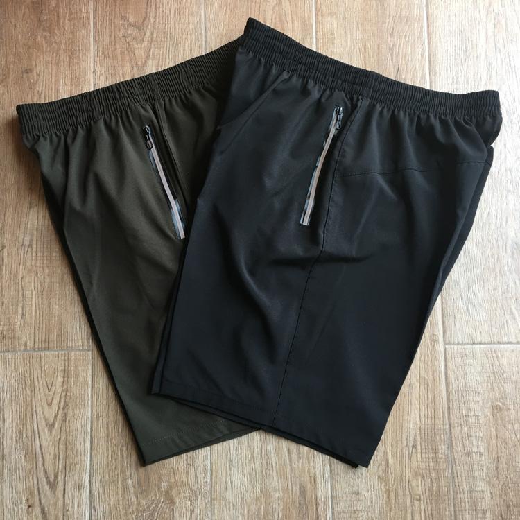 男士弹力运动速干裤户外快干短裤宽松加肥加大码薄夜跑反光沙滩裤