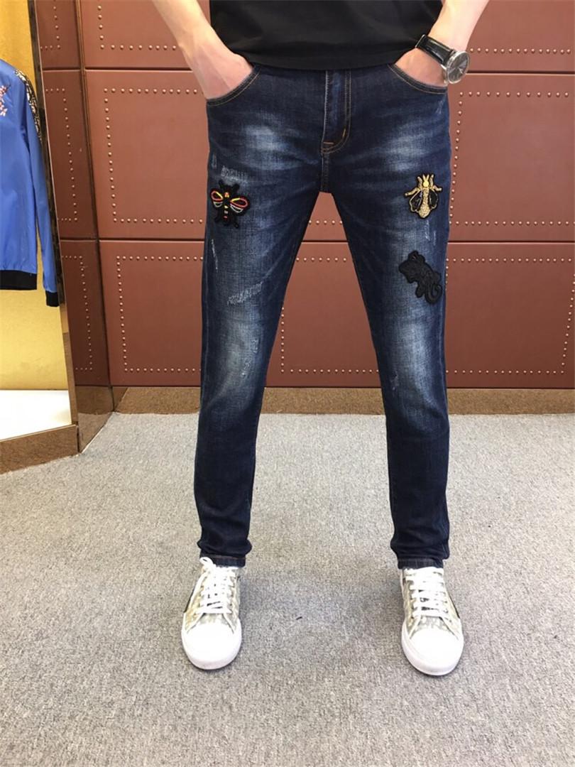 秋冬季原创设计深兰色弹力小脚裤男士破洞潮流休闲修身韩版牛仔裤