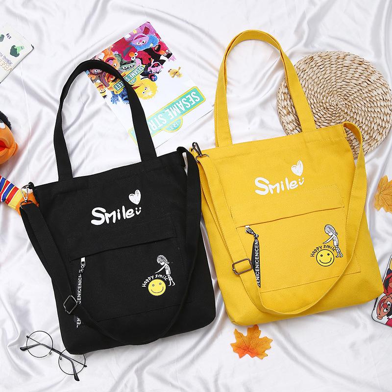 韓国版のズックの単独のショルダーバッグの斜めにまたがるハンドバッグのズックバッグの女性の美術袋の補習袋のカジュアルな学生のハンドバックのカバン