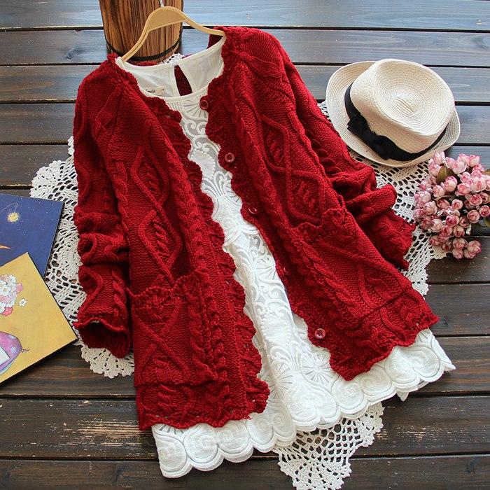 2021春の服装の新型の日は小さい清の新森の女性を結んで透かしている麻の花の辺の純色のボタンの編み物のカーディガンの短い上着を結びます