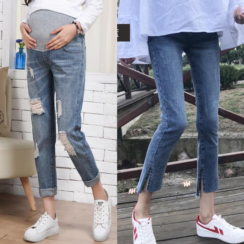 2020新型妊婦ジーンズ春季お父さんズボン春物新型穴が開いて腹のズボンのゆったりしているズボンのズボンを支えます。
