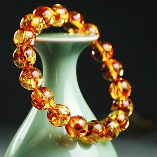 天然の琥珀金パープル108粒の仏ビーズのシングルリングのポーロの海の蜜蝋の水玉の手は男女の金を刺し連ねます。