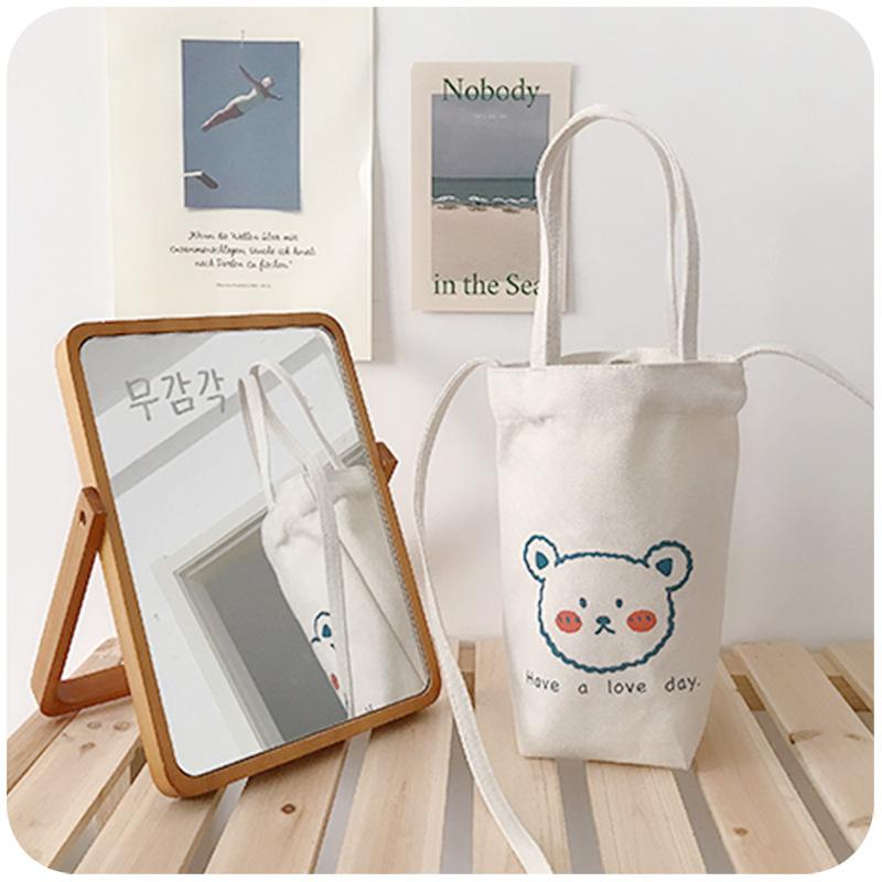 ins风文艺日系水杯袋子复古学生帆布包放手机手提手拎斜挎小包包