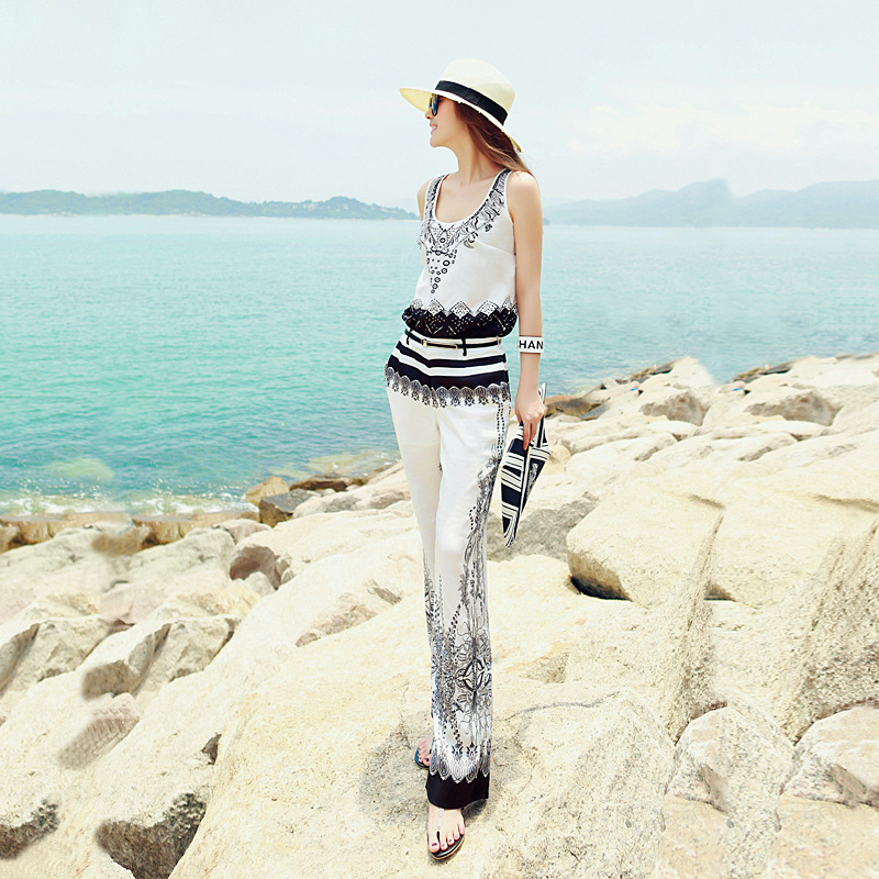 2020 new European and American show print shoulder loose shoulder pants high waist thin seaside holiday travel wide leg Jumpsuit