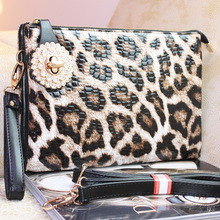 The new 2015 spring and summer fashion female package the leopard grain bag change mobile phone dinner makeup bag aslant hand bag