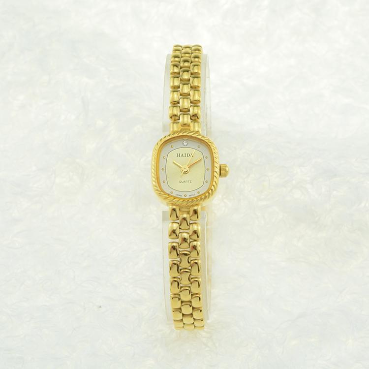 上海产海达手表,方形小巧迷你带钻手链正品镀金石英女表库存全新