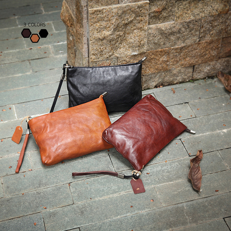 11月02日最新优惠进口植鞣皮复古男女款中性手拿包