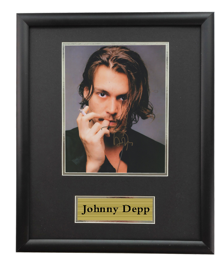Framed photos of Johnny Depp caribbean pirates with SA certificate