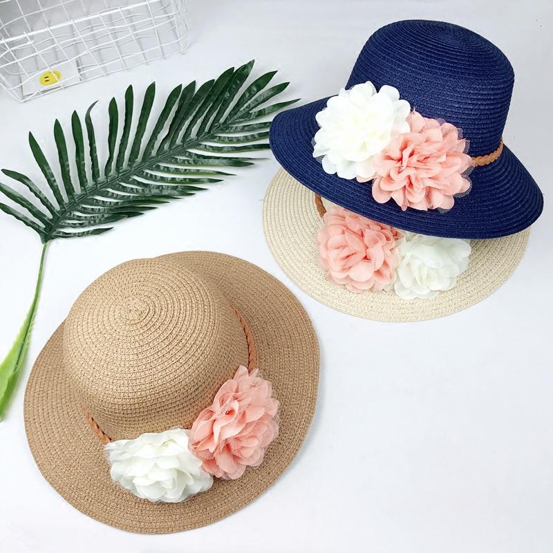 景點熱銷遮陽帽夏天沙灘帽出游韓版潮女花朵盆帽防曬帽子草帽