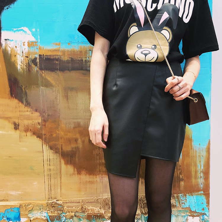 European and American fashion design sense irregular PU leather skirt A-line high waist skirt with short buttocks and thin one step skirt spring and summer female