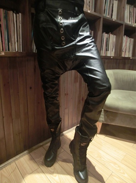 Faux leather is always a hot style and this season you do not want to be without a pair of our Faux Leather Tie String Harem Pants. These sexy sweat pant style features a shiny faux leather finish and will have you looking like a fashionista all year.