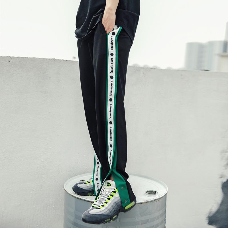 嘻哈街舞潮牌男女宽松侧开叉运动裤串标复古休闲校园长裤 AMONSTER
