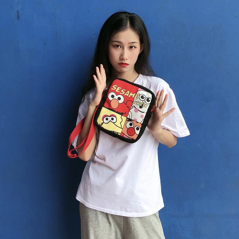 网红卡通手机包少女儿童可爱胸前挎包芝麻街图案帆布包零食包学生