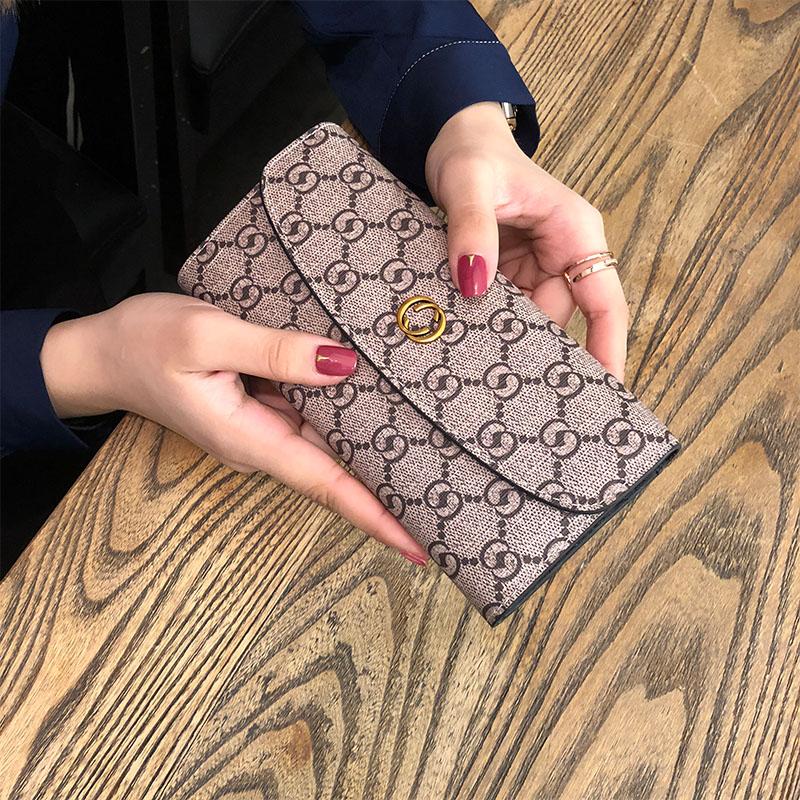 新款真皮长款钱包女时尚简约牛皮搭扣钱夹小钱包 2018 香港代购钱包