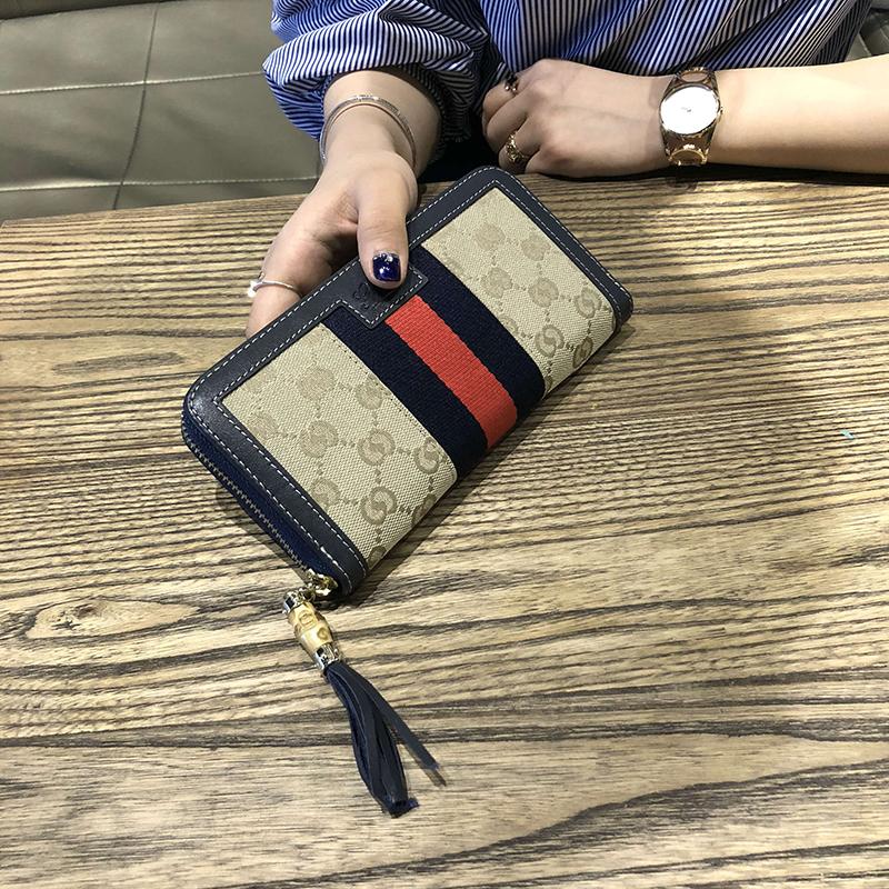 秋季新款女士时尚大牌大钞夹手拿小钱包 2018 香港代购流苏长款钱包